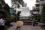 People pray to a statue of &quot;Phat Thich Ca Mau Ni&quot; or &quot;Sakyamuni Buddha&quot; at the Giac Lam Pagoda in Tan Binh District in Ho Chi Minh City, Vietnam. Photo taken Tuesday, May 4, 2010....Kevin German / LUCEO