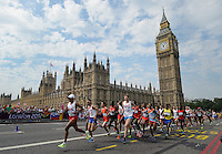 London, England - August 12: Mebrahtom Keflezighi of the USA leads the 2012 London Men's Marathon along Westminster Bridge next to the Palace of Westminster.