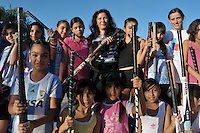 Alicia Romero and the hockey team they created in Lomas de Zamora to give the girls alternatives and occupations