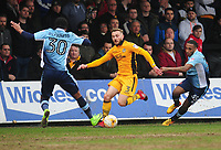 Newport County's Dan Butler is tackled by Blackpool's Nathan Delfouneso<br /> <br /> Photographer Kevin Barnes/CameraSport<br /> <br /> The EFL Sky Bet League Two - Saturday 18th March 2017 - Newport County v Blackpool - Rodney Parade - Newport<br /> <br /> World Copyright &copy; 2017 CameraSport. All rights reserved. 43 Linden Ave. Countesthorpe. Leicester. England. LE8 5PG - Tel: +44 (0) 116 277 4147 - admin@camerasport.com - www.camerasport.com