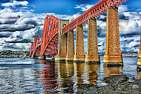 Looking up and across at the Firth of Forth rail bridge in South Queensferry Scotland.
