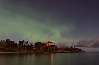 A view of the northern lights over Lake Superior and a moonlit Marquette Harbor Lighthouse. The bright moon helped light up the clouds and historic lighthouse. Marquette, MI