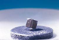 SUPERCONDUCTOR: MEISSNER EFFECT.Diamagnetism Created With Liquid Nitrogen..Liquid nitrogen brings ceramic disc formulated from the oxides of Yttrium, Barium, and Copper (YBa2Cu3O7) to its superconducting diamagnetic state preventing any magnetic field from entering it, which causes the small magnet to levitate.
