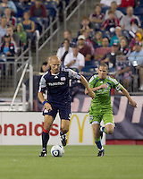 New England Revolution forward Ilija Stolica (9) starts forward as Seattle Sounders FC midfielder Osvaldo Alonso (6) closes. The New England Revolution defeated the Seattle Sounders FC, 3-1, at Gillette Stadium on September 4, 2010.