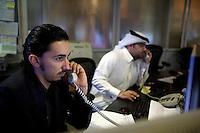 Journalists work in the newsroom of news channel Al Jazeera in Doha.