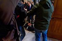 Roma 27 Febbraio 2015<br /> Attivisti dei  movimenti per il diritto all&rsquo;abitare hanno occupato la chiesa di Santa Maria del Popolo a Piazza del Popolo, per protestare contro  la manifestazione di Matteo Salvini segretario della Lega Nord. Le forze dell'ordine hanno sgomberato la chiesa, fermando due manifestanti. Un manifestante viene trascinato dale forze dell'ordine<br /> Rome February 27, 2015<br /> Movement activists for the right to housing have occupied the church of Santa Maria del Popolo, to Piazza del Popolo, to protest the event of Matteo Salvini secretary of the Northern League. The police have vacated the church, stopping two protesters. &nbsp; A protester is dragged by the police
