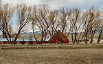 Idaho, North Central, Donnelly. Barn and irrigation line near Donnelly in spring.