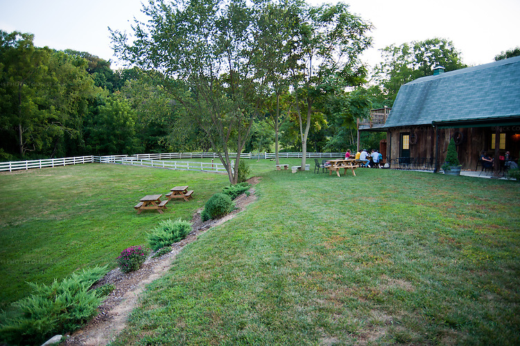 Dry Mill Winery has a large yard with multiple levels, featuring neat gardening and multiple places to sit and enjoy a snack while sampling the local wine.