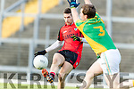 Paul O' Connor Kenmare in action against Paul Carkill Kilfenora in the Munster Intermediate Club Football Championship Semi-Final at Fitzgerald Stadium on Sunday.