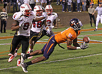 Nov 13, 2010; Charlottesville, VA, USA;  Virginia Cavaliers wide receiver Dontrelle Inman (81) can't make the catch in front of Maryland Terrapins linebacker Demetrius Hartsfield (9), Maryland Terrapins defensive back Eric Franklin (48) and Maryland Terrapins defensive back Antwine Perez (2) during the 1st half of the game at Scott Stadium.  Mandatory Credit: Andrew Shurtleff