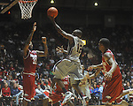 "Ole Miss guard Chris Warren (12) shoots as Arkansas' Marshawn Powell (33) defends at C.M. ""Tad"" Smith in Oxford, Miss. on Saturday, March 5, 2010. Mississippi won 84-74."