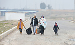 Fleeing the Islamic State, a family walks into government-controlled territory in Mosul, Iraq, on January 27, 2017. The Iraqi army, including elite counter-terror commandos, drove the Islamic State group out of the eastern part of the city in early in 2017. Despite the city's new freedom, Christians are unlikely to return soon due to concerns about their security in the largely Sunni Muslim community.
