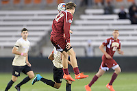 Houston, TX - Friday December 9, 2016: Karsten Hanlin (17) of the Denver Pioneers wins a header over Jacori Hayes (8) of the Wake Forest Demon Deacons at the NCAA Men's Soccer Semifinals at BBVA Compass Stadium in Houston Texas.