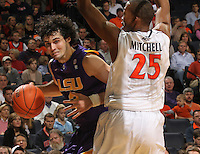 Jan. 2, 2011; Charlottesville, VA, USA; LSU Tigers forward Garrett Green (3) drives past Virginia Cavaliers forward Akil Mitchell (25) during the game at the John Paul Jones Arena. Mandatory Credit: Andrew Shurtleff