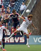 New England Revolution midfielder Kelyn Rowe (11) and DC United midfielder Nick DeLeon (18) battle for head ball. In a Major League Soccer (MLS) match, DC United defeated the New England Revolution, 2-1, at Gillette Stadium on April 14, 2012.