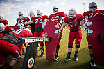 FRESNO, CA - AUGUST 11, 2014:   Fresno State's defensive line moves their blocking sled during morning practice. CREDIT: Max Whittaker for The New York Times