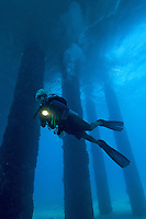 Diver beneath the Fredericksted Pier, Fredericksted, St. Croix<br /> U.S Virgin Islands