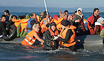 Helped by volunteers, a refugee woman disembarks from a rubber raft onto a beach near Molyvos, on the Greek island of Lesbos, on October 30, 2015. She and the other refugees crossed the Aegean Sea from Turkey and were received by local and international volunteers. They then proceeded on their way toward western Europe. The boat was provided by Turkish traffickers to whom the refugees paid huge sums to arrive in Greece.