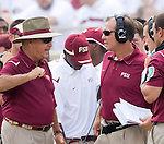 Florida State head coach Bobby Bowden, left, has a disagreement with offensive coordinator and head coach in waiting Jimbo Fisher after former Lincoln High standout and Bulls quarterback B.J. Daniels drove his unranked team the full length of the field for a touchdown in the first half of a 17-7 defeat of the Seminoles in their NCAA football game in Tallahassee, Florida September 26, 2009.  (Mark Wallheiser/TallahasseeStock.com)
