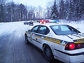 Provincial police car at scene of road accident on a winter afternoon