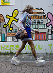 A transvestite dressed in a cosply costume walks through Harajuku in Tokyo