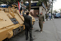 Men have their picture taken in front of an armored personell carrier in Cairo, after the revolution that saw president Hosni Mubarak ousted from office. The army took over security in the city following the revolution.
