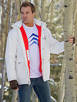 man in winter clothes outdoors surrounded by Aspen Trees in New Mexico