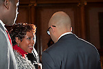 January 11, 2012 - Brooklyn, New York, USA: (Left to right) Mayor Joseph Champagne of South Toms River, NJ; U.S. Congresswoman Yvette Clarke; Counsul General of Haiti, Charles A. Forbin (seen from back), at 2nd Annual Interfaith Memorial Service for Haiti, Wednesday night at Brooklyn Borough Hall.
