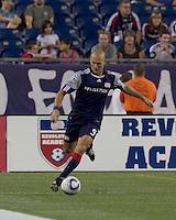 New England Revolution forward Ilija Stolica (9) crosses the ball. The New England Revolution tied Columbus Crew, 2-2, at Gillette Stadium on September 25, 2010.