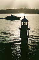 Sydney Harbour navigation light and early morning ferry.<br /> <br /> For larger JPEGs and TIFF Contact EFFECTIVE WORKING IMAGE via our contact page at : www.photography4business.com