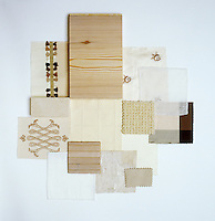 A collection of fabric swatches and a wood sample illustrating the colour range from snow to rice pudding