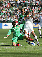 Fausto Pinto (5) slide tackles Rudel Calero (8). Mexico defeated Nicaragua 2-0 during the First Round of the 2009 CONCACAF Gold Cup at the Oakland, Coliseum in Oakland, California on July 5, 2009.