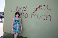 """Taking a picture in front of the famous """"I love you so much"""" mural in South Congress is a fun thing to do and a famous tourist landmark - Stock Image."""