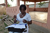 Parakou,Benin. December 2009. Judith Bio, GRADH. In Benin the challenge is to ensure that working children continue their education. With the assistance of partners like UNICEF, a law was recently voted in by parliament that regulates the movement of children inside the country. A local NGO, GRADH, asssists in getting working children educated. They negotiate with parents/bosses to let them come to classes. This class has 15 regular students.