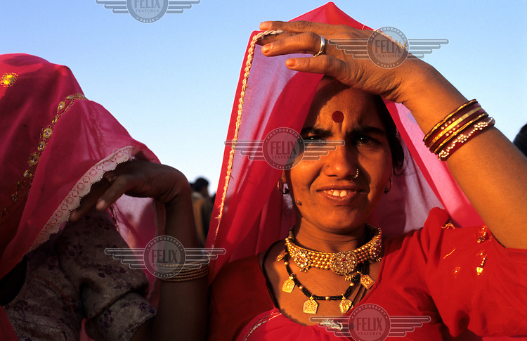 A woman dressed up to attend a camel festival.