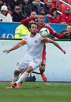 20 April 2013:Toronto FC forward Justin Braun #17 and Houston Dynamo midfielder Adam Moffat #16 in action during the first half in an MLS game between the Houston Dynamo and Toronto FC at BMO Field in Toronto, Ontario Canada...