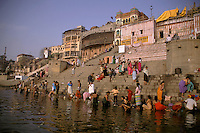 India, Uttar Pradesh, Varanasi, Ganges River, ghats & early morning bathers