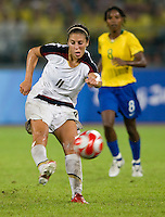 USWNT midfielder (11) Carli Lloyd takes a shot while playing for the gold medal at Workers' Stadium.  The USWNT defeated Brazil, 1-0, during the 2008 Beijing Olympic final in Beijing, China.