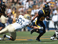 Cal's Isi Sofele (20) escapes UC Davis's Tommy Grillo (56). The University of California Berkeley Golden Bears defeated the UC Davis Aggies 52-3 in their home opener at Memorial Stadium in Berkeley, California on September 4th, 2010.