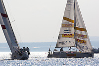 Jesper Radich leads Bjorn Hansen around the windward mark on day 2 of Match Race Germany. World Match Racing Tour. Langenargen, Germany. 21 May 2010.