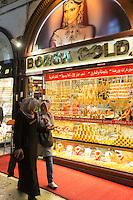 Muslim women by goldsmiths jewelry shop in The Grand Bazaar, Kapalicarsi, great market, Beyazi, Istanbul, Republic of Turkey