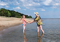 Mother and daughter standing on Kauksi beach. Lake Peipsi in Estonia.