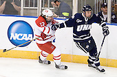 Trent Vogelhuber (Miami - 13), Connor Hardowa (UNH - 2) - The University of New Hampshire Wildcats defeated the Miami University RedHawks 3-1 (EN) in their NCAA Northeast Regional Semi-Final on Saturday, March 26, 2011, at Verizon Wireless Arena in Manchester, New Hampshire.