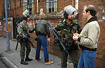 Belfast Ireland 1980s, British soldiers stop and search on the street of Belfast.