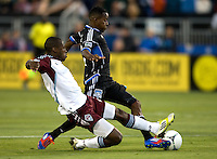 Luis Zapata of Rapids tries to tackle the ball against Marvin Chavez of Earthquakes during the game at Buck Shaw Stadium in Santa Clara, California on August 25th, 2012.   San Jose Earthquakes defeated Colorado Rapids, 4-1.