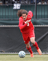 University of New Mexico forward Devon Sandoval (9) on the attack. .NCAA Tournament. With a goal in the second overtime, University of Connecticut (white) defeated University of New Mexico (red), 2-1, at Morrone Stadium at University of Connecticut on November 25, 2012.