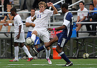 HYATTSVILLE, MD - OCTOBER 26, 2012:  Nolan Axenfeld (21) of DeMatha Catholic High Schoo pokws the ball away from Azaan Wilbon (15)l of St. Albans during a match at Heurich Field in Hyattsville, MD. on October 26. DeMatha won 2-0.