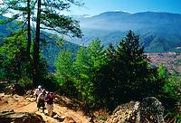 Tourist and locals trekking in Bhutan