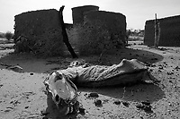 Normi, North Darfur, August 24, 2004.In the ruins of this village burned a year ago by janjaweed militia.