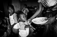 A young boy receives a meal at a day-care centre for orphans in Lilongwe, Malawi on April 8, 2001.  More than 13 million African children have been orphaned by the the AIDS pandemic..Worldwide, more than 20 million people have died since the first cases of AIDS were identified in 1981.